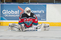 KELOWNA, CANADA - NOVEMBER 5: Michael Herringer #30 of Kelowna Rockets stretches on the ice during warm up against the Victoria Royals on November 5, 2014 at Prospera Place in Kelowna, British Columbia, Canada.  (Photo by Marissa Baecker/Shoot the Breeze)  *** Local Caption *** Michael Herringer;