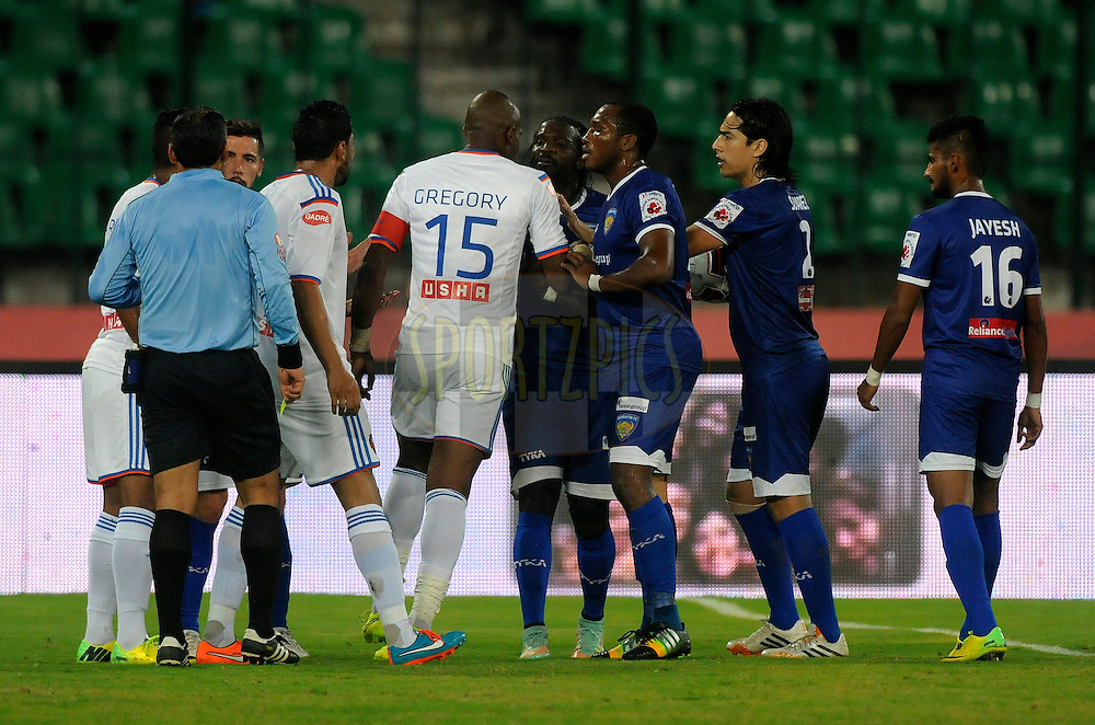 Gregory Arnolin of FC Goa and Bernard Mendy of Chennaiyin FC argue during match 50 of the Hero Indian Super League between Chennaiyin FC and FC Goa held at the Jawaharlal Nehru Stadium, Chennai, India on the 5th December 2014.<br /> <br /> Photo by:  Pal Pillai/ ISL/ SPORTZPICS