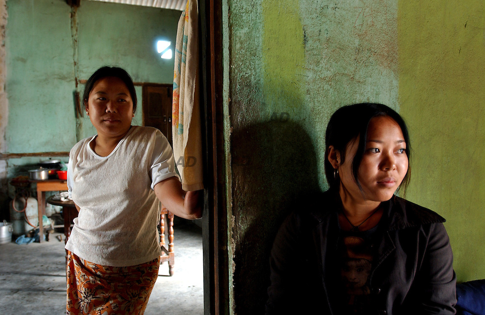 Mrs Shuan's daughter and daughter in law of the Dai Minority in village of Hefei. Mrs Shuan's husband is heroin addict..