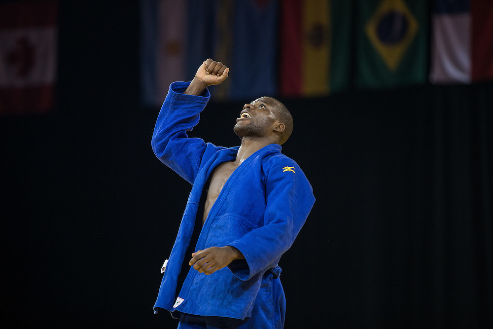Pedro Castro of Colombia celebrates his bronze medal win over Zachary Burt of Canada in the men's judo -81kg class at the 2015 Pan American Games in Toronto, Canada, July 13,  2015.  AFP PHOTO/GEOFF ROBINS