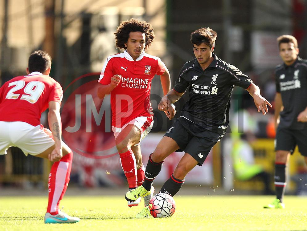 Liverpool's Joao Teixeira takes on the Swindon Town defenders - Mandatory by-line: Robbie Stephenson/JMP - 07966386802 - 02/08/2015 - SPORT - FOOTBALL - Swindon,England - County Ground - Swindon Town v Liverpool - Pre-Season Friendly