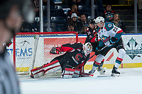 KELOWNA, CANADA - MARCH 14:  Taylor Gauthier #35 misses a save as Josh Maser #11 of the Prince George Cougars checks Braydyn Chizen #22 of the Kelowna Rockets on March 14, 2018 at Prospera Place in Kelowna, British Columbia, Canada.  (Photo by Marissa Baecker/Shoot the Breeze)  *** Local Caption ***