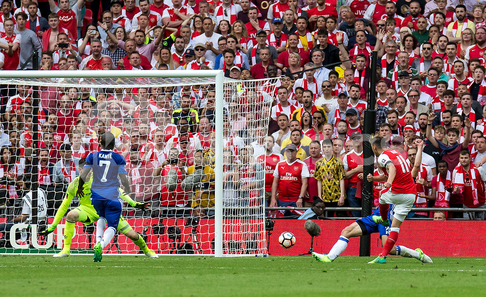 Mesut Ozil of Arsenal shoots during the Emirates FA Cup Final between Arsenal and Chelsea at Wembley Stadium, London, England on the 27th May 2017. Photo by Liam McAvoy.