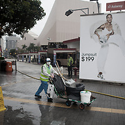 A cleaner in Kowloon, near the bus terminal and the Star Ferry termnal.  The streets of Hong Kong are kept clean by an army of street cleaners, many elderly men and women.<br />