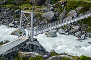 First swing bridge on Hooker Valley Track, in Aoraki / Mount Cook National Park, Canterbury region, South Island, New Zealand. In 1990, UNESCO honored Te Wahipounamu - South West New Zealand as a World Heritage Area.