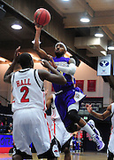 November 28, 2011; Moraga, CA, USA; San Francisco State Gators guard Nefi Perdomo (top) shoots the ball over Jacksonville State Gamecocks forward Stephen Hall (2) during the first half of the Shamrock Office Solutions Classic consolation game at McKeon Pavilion.