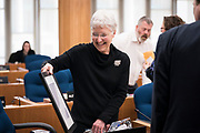 Ledell Zellers, Alder, District 2, smiles as she opens a parting gift before the swearing in ceremony for Satya Rhodes-Conway and newly elected Alders at the City County Building in Madison, WI on Tuesday, April 16, 2019.