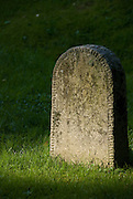 """One of the oldest grave stones in Skogskyrkogården, or The Woodland Cemetery, this simple marker contains the name """"Olof"""" and the date 1922.  Designed by Gunnar Asplund and Sigurd Lewertz  in 1915, the cemetery's use of the natural landscape has had a profound effect on cemetery design throughout the world, and in 1994 Skogskyrkogården was named a UNESCO World Heritage Site."""