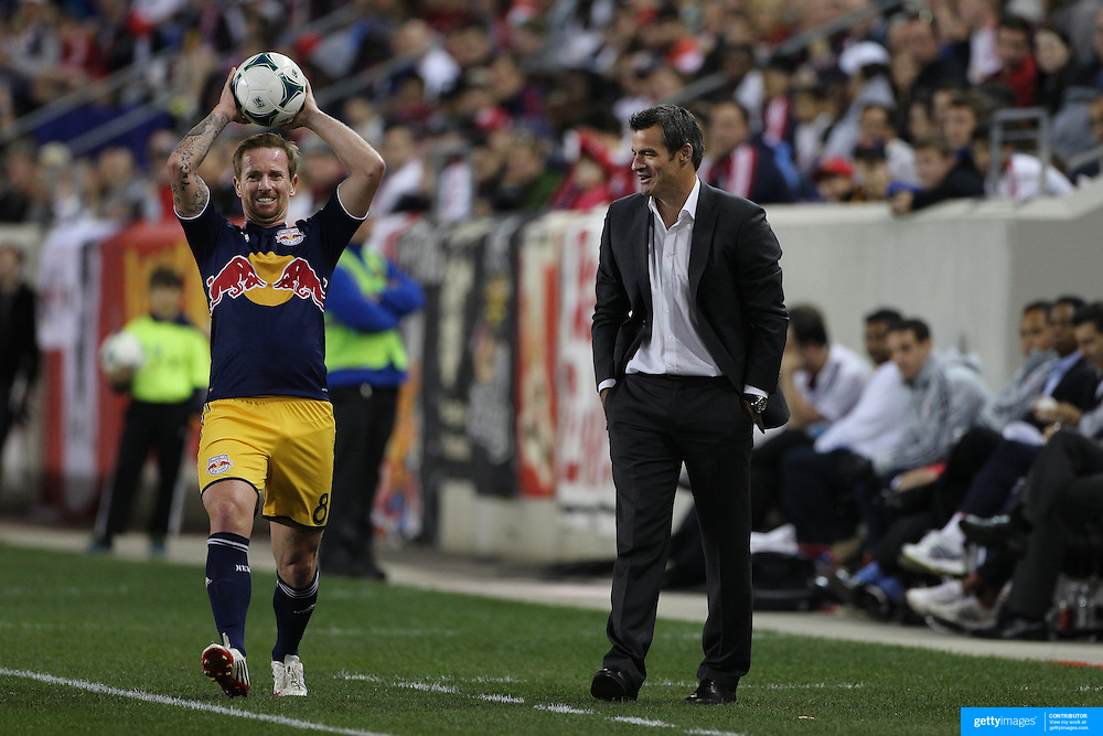 A funny moment as New Zealander Ryan Nelson, (right), the Toronto FC Coach, banters with Australian International player David Carney, New York Red Bulls, as he takes throwing close to the Toronto bench during the New York Red Bulls V Toronto FC, Major League Soccer, regular season match at Red Bull Arena, Harrison, New Jersey. USA. 14th September 2013. Photo Tim Clayton