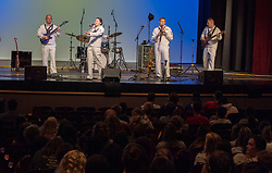 CLEVELAND (Aug. 29, 2018) Sailors attached to the U.S. Fleet Forces Band perform for students at Rocky River High School during Cleveland Navy Week in Cleveland, Ohio. The Navy Office of Community Outreach uses the Navy Week program to bring Navy Sailors, equipment and displays to approximately 14 American cities each year for a week-long schedule of outreach engagements designed for Americans to experience firsthand how the U.S. Navy is the Navy the nation needs. (U.S. Navy photo by Mass Communication Specialist 2nd Class Tamara Vaughn/Released) 180829-N-RJ834-010