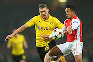 Alexis Sanchez of Arsenal and Lukasz Piszczek of Borussia Dortmund fight for the ball during the UEFA Champions League match at the Emirates Stadium, London<br /> Picture by Richard Calver/Focus Images Ltd +447792 981244<br /> 26/11/2014