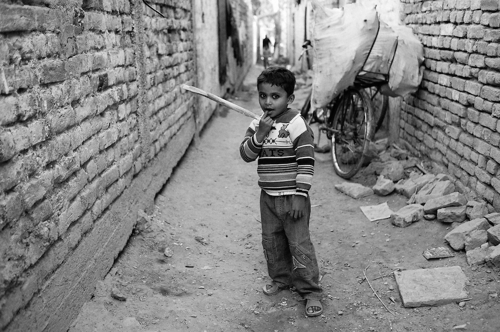 A little boy playing with a stick in one of the alleys in the French Colony slum in the city center of Islamabad. The Christian community of the city live in poor conditions and are discriminated against on the basis of their religion.
