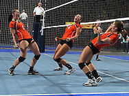Tripoli's Sara Hoppenworth (1), Megan Gilbert (6), and Ashlen Damm (8) celebrate a score during their 1A semifinal match in the state volleyball tournament at the U.S. Cellular Center at 370 1st Ave E on Friday evening, November 12, 2010. (Stephen Mally/Freelance)