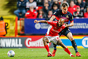 Doncaster Rovers defender Andrew Butler (6) holds and fouls Charlton Athletic midfielder Josh Parker (10) during the EFL Sky Bet League 1 second leg Play-Off match between Charlton Athletic and Doncaster Rovers at The Valley, London, England on 17 May 2019.