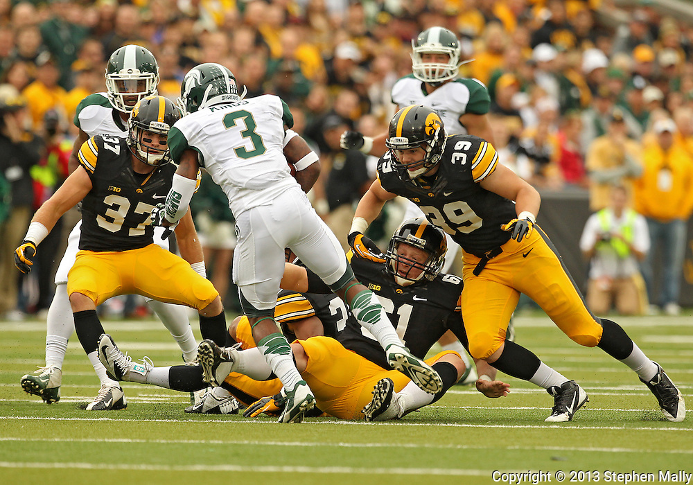 October 6 2013: Iowa Hawkeyes defensive back John Lowdermilk (37) and Iowa Hawkeyes defensive back Travis Perry (39) close in on Michigan State Spartans returner Macgarrett Kings Jr. (3) during the first quarter of the NCAA football game between the Michigan State Spartans and the Iowa Hawkeyes at Kinnick Stadium in Iowa City, Iowa on October 6, 2013. Michigan State defeated Iowa 26-14.