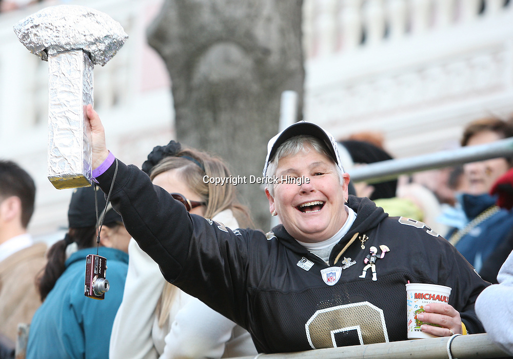 Feb 09, 2010; New Orleans, LA, USA; A New Orleans Saints fan holds up a mock up of the Vince Lombardi Trophy during the Super Bowl celebration parade for the New Orleans Saints 31-17 victory over the Indianapolis Colts in Super Bowl XLIV as the parade passed through the downtown streets of New Orleans, Louisiana.  Mandatory Credit: Derick E. Hingle-US-PRESSWIRE.