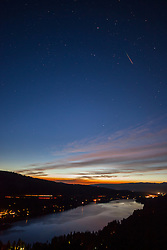 """Meteor Over Donner Lake"" - Photograph of a meteor during the August 13, 2015 Perseid meteor shower. Shot above Donner Lake and Truckee, California at sunrise (5:09 am)."