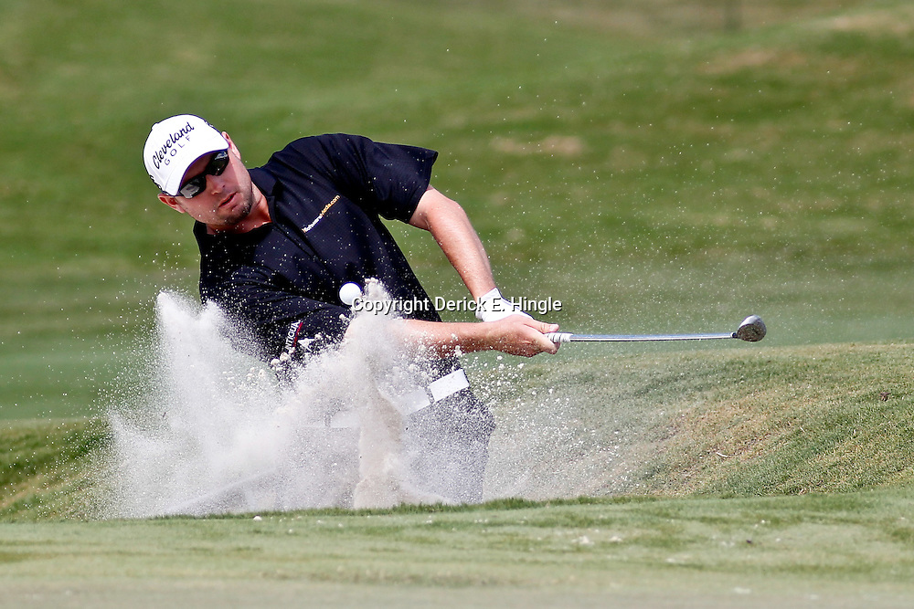 Apr 27, 2012; Avondale, LA, USA; Troy Kelly hits from a bunker on the 18th hole during the second round of the Zurich Classic of New Orleans at TPC Louisiana. Mandatory Credit: Derick E. Hingle-US PRESSWIRE