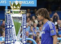Football - 2014 / 2015 Premier League - Chelsea vs. Sunderland.   <br /> <br /> Nathan Ake of Chelsea walks past the Premier League trophy at Stamford Bridge. <br /> <br /> COLORSPORT/DANIEL BEARHAM