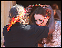 The Duchess of Cambridge is given a necklace during  a Welcome to Country display at Ayers Rock, Australia,Tuesday, 22nd April 2014. Picture by Stephen Lock / i-Images