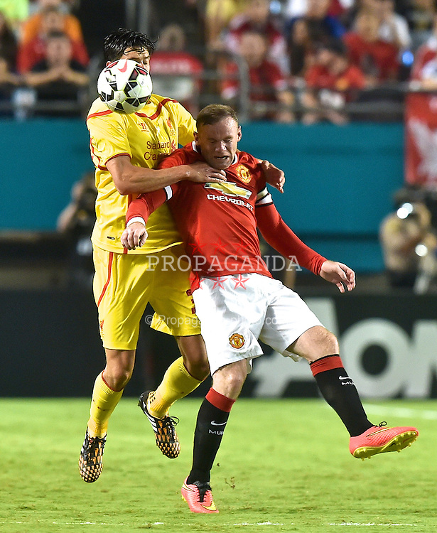 MIAMI, USA - Monday, August 4, 2014: Liverpool's Martin Kelly in action against Manchester United's Wayne Rooney during the International Champions Cup Final match at the SunLife Stadium on day fifteen of the club's USA Tour. (Pic by David Rawcliffe/Propaganda)