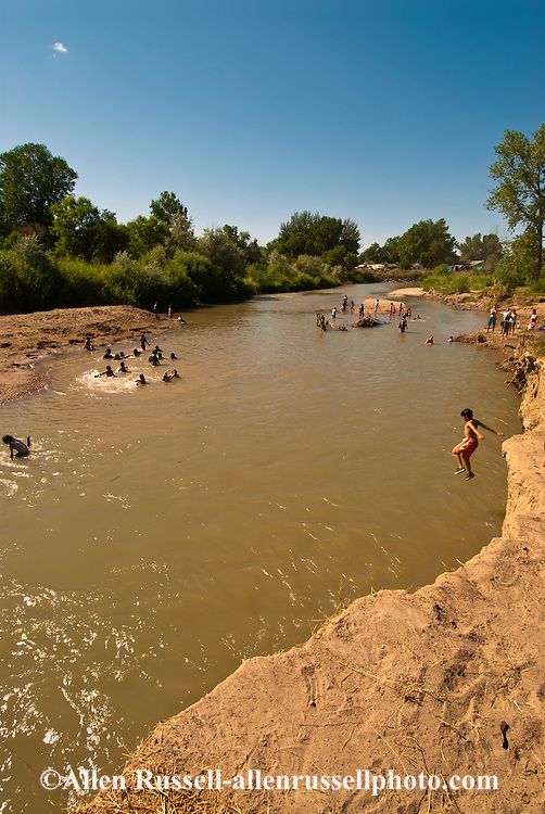 Crow Fair, Boy dives,  Little Bighorn River, Crow Agency, Crow Indian Reservation, Montana