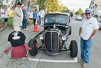 "Les Sanborn better known as the ""Rod Father"" stands alongside his 1938 Ford Pickup on Main Street in Meredith Saturday evening following the Cruise Night Parade.  Sanborn has a varied collection of 60 cars.  (Karen Bobotas/for the Laconia Daily Sun)"