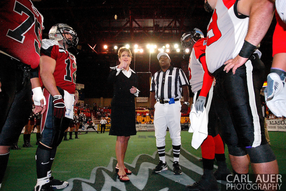 Alaska Governor Sarah Palin participates in the coin toss prior to a Alaska Wild football game.