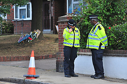© Licensed to London News Pictures. 01/09/2016<br /> Penge car chase scene today (01.09.2016).<br /> <br /> Flowers and police at Lennard Road,Penge, the scene of yesterdays car chase which left a 10 year old boy and his aunt dead.<br />  <br /> <br /> <br /> <br /> (Byline:Grant Falvey/LNP)