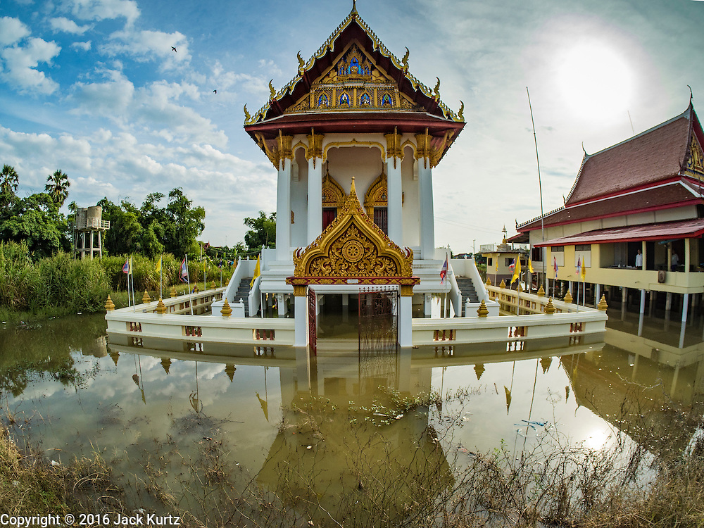 30 SEPTEMBER 2016 - SAI NOI, AYUTTHAYA, THAILAND: A prayer hall at the flooded Wat Boonkannawas in Sai Noi. The Chao Phraya River, the largest river that runs through central Thailand, has hit flood stage in several areas in Ayutthaya and Ang Thong provinces. Villages along the river are flooded and farms are losing their crops due to the flood. This is the same area that was devastated by floods in 2011, but the floods this year are not expected to be as severe. The floods are being fed by water released from upstream dams. The water is being released to make room for heavy rains expected in October.      PHOTO BY JACK KURTZ