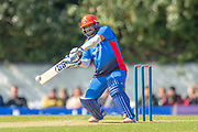 Afghan opening batsman Mohammad Shazad plays a shot during the One Day International match between Scotland and Afghanistan at The Grange Cricket Club, Edinburgh, Scotland on 10 May 2019.