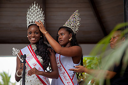 "Steffi Nichols is crowned Miss St. John Festival Queen 2016 from former festival queen Shanell Harney.  The Festival & Cultural Organization of St. John Presents It's Annual Food Fair honoring Delroy ""Ital"" Anthony and Royal Coronation 2016.  Franklin A. Powell, Sr. Park.  St. John, US Virgin Islands.  26 June 2016.  © Aisha-Zakiya Boyd"