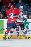 KELOWNA, CANADA - MARCH 5: Jason Fram #2 of the Spokane Chiefs checks Myles Bell #29 of the Kelowna Rockets into the boards on March 5, 2014 at Prospera Place in Kelowna, British Columbia, Canada.   (Photo by Marissa Baecker/Getty Images)  *** Local Caption *** Jason Fram; Myles Bell;
