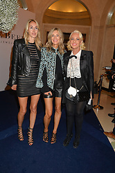 Left to right, KARINA BRIGNONE, KIM HERSOV and AMANDA ELIASCH at the De Beers Moments in Light - a celebration of telented women in association with Women For Women International featuring photographs by Mary McCartney held at Claridge's, Brook Street, London on 18th September 2015.
