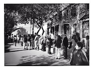 Mexican citizens line up outside US consular services building which sits in the no man's land between the Mexican border line and the immigration inspection ahead, San Ysidro, California, USA.