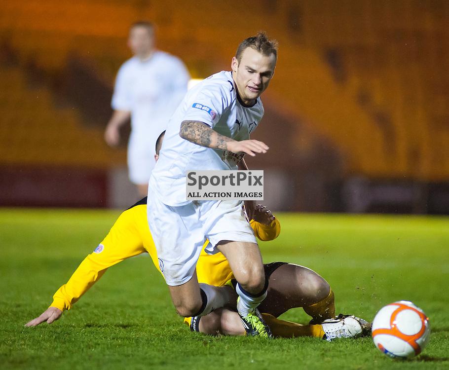 Kallum Higgonbotham is fouled by Mark Fotheringham, Livingston v Falkirk, SFL Division 1, Braidwood Motor Company Stadium, Monday 2nd January 2012