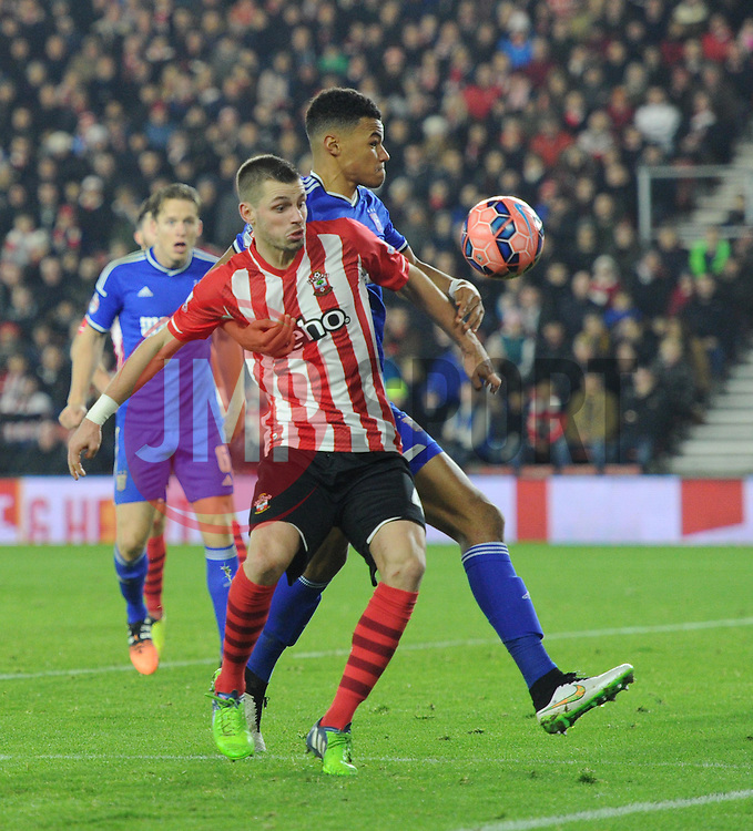 Ipswich Town's Tyrone Mings and Southampton's Morgan Schneiderlin compete for the ball - Photo mandatory by-line: Paul Knight/JMP - Mobile: 07966 386802 - 04/01/2015 - SPORT - Football - Southampton - St Mary's Stadium - Southampton v Ipswich Town - FA Cup Third Round