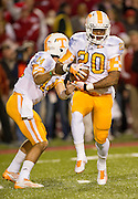 Nov 12, 2011; Fayetteville, AR, USA; Tennessee Volunteers quarterback Justin Worley (14) hands the ball off to defensive back Robert Yonce (20) during the first half of a game against the Arkansas Razorbacks at Donald W. Reynolds Razorback Stadium. Arkansas defeated Tennessee 49-7. Mandatory Credit: Beth Hall-US PRESSWIRE