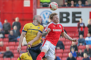 David Mirfin (Scunthorpe United) wins the ball and clears the danger during the Sky Bet League 1 match between Barnsley and Scunthorpe United at Oakwell, Barnsley, England on 25 March 2016. Photo by Mark P Doherty.