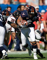 Virginia running back Mikell Simpson (5) breaks a tackle by Texas Tech linebacker Marlon Williams (39).  The Texas Tech Red Raiders defeated the Virginia Cavaliers 31-28 in the 2008 Konica Menolta Gator Bowl held at the Jacksonville Municipal Stadium in Jacksonville, FL on January 1, 2008.