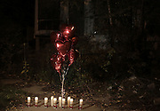 During a vigil at 2200 Massachusetts St. in Gary where an unidentified female victim was found balloons and candles are placed in memory of the seven female victims.