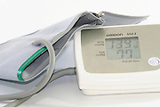 Hypertension - Blood Pressure and heart rate monitor device on white background