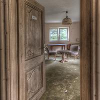Old very moldy hotel.<br /> Hotel Schimmelig interior with doorway