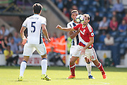 Middlesbrough forward Christian Stuani (18) and West Bromwich Albion defender, on loan from Everton, Brendan Galloway (20) battle for the ball during the Premier League match between West Bromwich Albion and Middlesbrough at The Hawthorns, West Bromwich, England on 28 August 2016. Photo by Simon Davies.