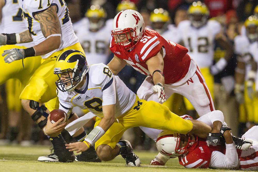 Ciante Evans (17) and Will Compton (51) of the Nebraska Cornhuskers sack Russell Bellomy (8) of the Michigan Wolverines during Nebraska's 23-9 victory over Michigan on Oct. 27, 2012 at Memorial Stadium in Lincoln, Neb.