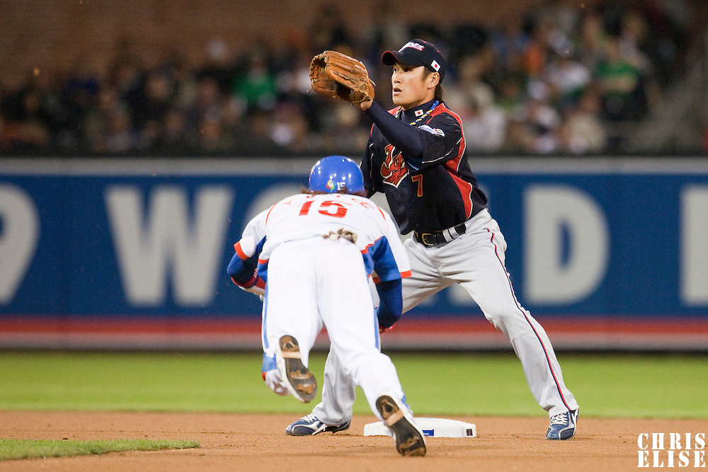 17 March 2009:  #15 Yong Kyu Lee of Korea slides into second base safely from first base against #7 Yasuyuki Kataoka of Japan during the 2009 World Baseball Classic Pool 1 game 4 at Petco Park in San Diego, California, USA. Korea wins 4-1 over Japan.