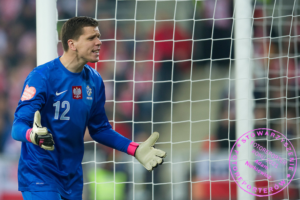 Poland's goalkeeper Wojciech Szczesny shouts during international friendly soccer match between Poland and Ireland at Inea Stadium in Poznan on November 19, 2013.<br /> <br /> Poland, Poznan, November 19, 2013<br /> <br /> Picture also available in RAW (NEF) or TIFF format on special request.<br /> <br /> For editorial use only. Any commercial or promotional use requires permission.<br /> <br /> Mandatory credit:<br /> Photo by © Adam Nurkiewicz / Mediasport