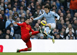 LUIS SUAREZ & DAVID SILVA.MANCHESTER CITY V LIVERPOOL FC.MANCHESTER CITY V LIVERPOOL FC, BARCLAYS PREMIER LEAGUE.ETIHAD STADIUM, MANCHESTER, ENGLAND.03 February 2013.GAQ65202..  .WARNING! This Photograph May Only Be Used For Newspaper And/Or Magazine Editorial Purposes..May Not Be Used For Publications Involving 1 player, 1 Club Or 1 Competition .Without Written Authorisation From Football DataCo Ltd..For Any Queries, Please Contact Football DataCo Ltd on +44 (0) 207 864 9121