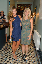 Left to right, ZOE HARDMAN and PIPS TAYLOR at the launch of Give Me Sport Magazine held at Library, 112 St.Martin's Lane, London on 30th July 2014.