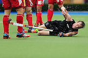 Hugo Inglis of New Zealand hits the ground after a clash during the bronze medal match between New Zealand and England. Glasgow 2014 Commonwealth Games. Hockey, Bronze Medal Match, Black Sticks Men v England, Glasgow Green Hockey Centre, Glasgow, Scotland. Sunday 3 August 2014. Photo: Anthony Au-Yeung / photosport.co.nz